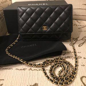Chanel caviar woc black gold hardware